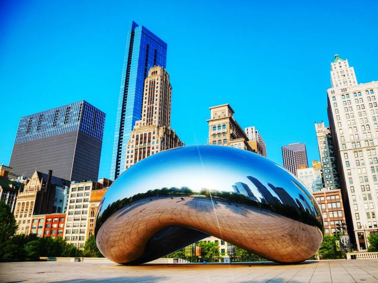 """ILLINOIS: Hop the """"L"""" to Millennium Park in downtown Chicago, which features modern architecture and public art, like """"Cloud Gate,"""" a giant bean-like sculpture that reflects the city's skyline."""