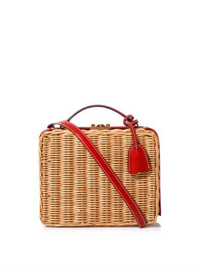 Mark Cross gives its signature Grace box bag a summery update in woven Rattan. It features a red calf leather top and secures with an 18ct gold-plated metal clasp. Tote yours by the top handle or lighten the load with the detachable shoulder strap.