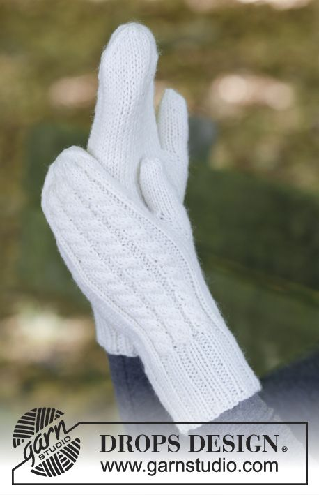 Knitted mittens with cables and textured pattern. The piece is worked in DROPS Karisma.