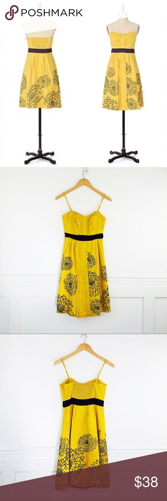 """Anthropologie Floreat Ile Royale dress Floreat Ile Royale Dress   Ocre yellow with eggplant waist and embroidered chrysanthemums on the skirt.  Smocked panel on the back.  Side zip.  Cotton with acetate lining.  Last photo shows a tiny stain on the skirt.   Size 4 Chest 15"""" Waist 14"""" Length 30"""" Anthropologie Dresses"""
