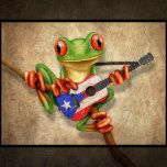 This cute design by artist Jeff Bartels features a small green tree frog holding a scratched and worn acoustic guitar. The flag of Puerto Rico is painted on to the old guitar giving it a patriotic look. The adorable tree frog musician is sitting on a small branch and is looking forward with its large red eyes. The over sized head and small body along with the details on the skin and guitar create a beautiful combination of a cartoon and realistic look. This unique and patriotic Puerto Rican…