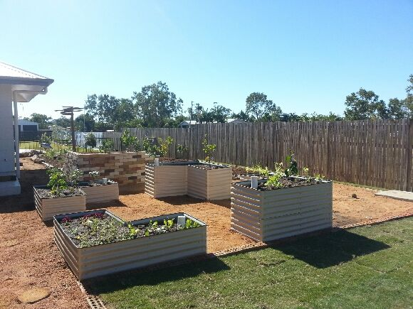 Raised garden beds encourages everyone to join in. Located directly in front of kitchen for easy accessability.