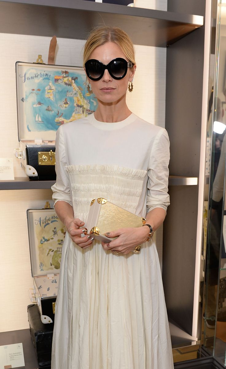 Laura Bailey wearing a Molly Goddard dress & a Globe-Trotter clutch bag at the Globe-Trotter and Sofia Sanchez de Betak collaboration launch in London
