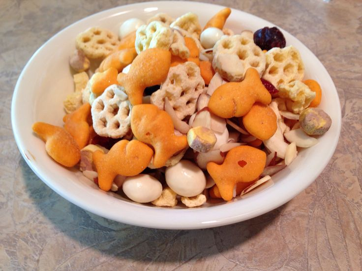 """""""Moses Mix"""" for night three of Wilderness Escape VBS 2014. Snacks that represent foods Egyptians would have eaten: fish, yogurt covered raisins, honeycomb, almonds, and dried fruit."""