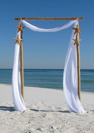 Tropical Island Sunset beach wedding so simple for the beach. Orlando wedding flowers | www.weddingsbycarlyanes.com