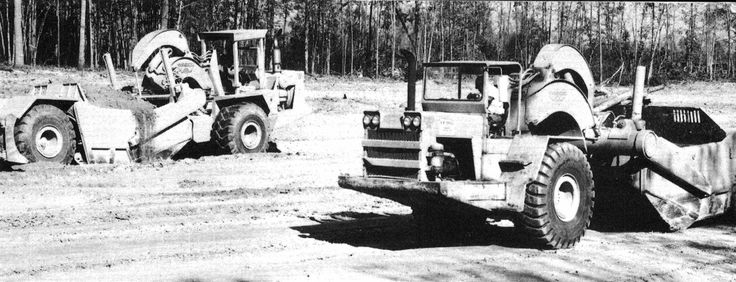 Near Petersburgh, Virginia, USA, two Wabco 229Gs go about shifting earth for a seven mile stretch of new highway. As can be seen, one of these machines belonging to W Tuck-Son is older than the other and is fitted with the traditional Wabco sun canopy while the newer machine has a ROPS. Photo dated 1974