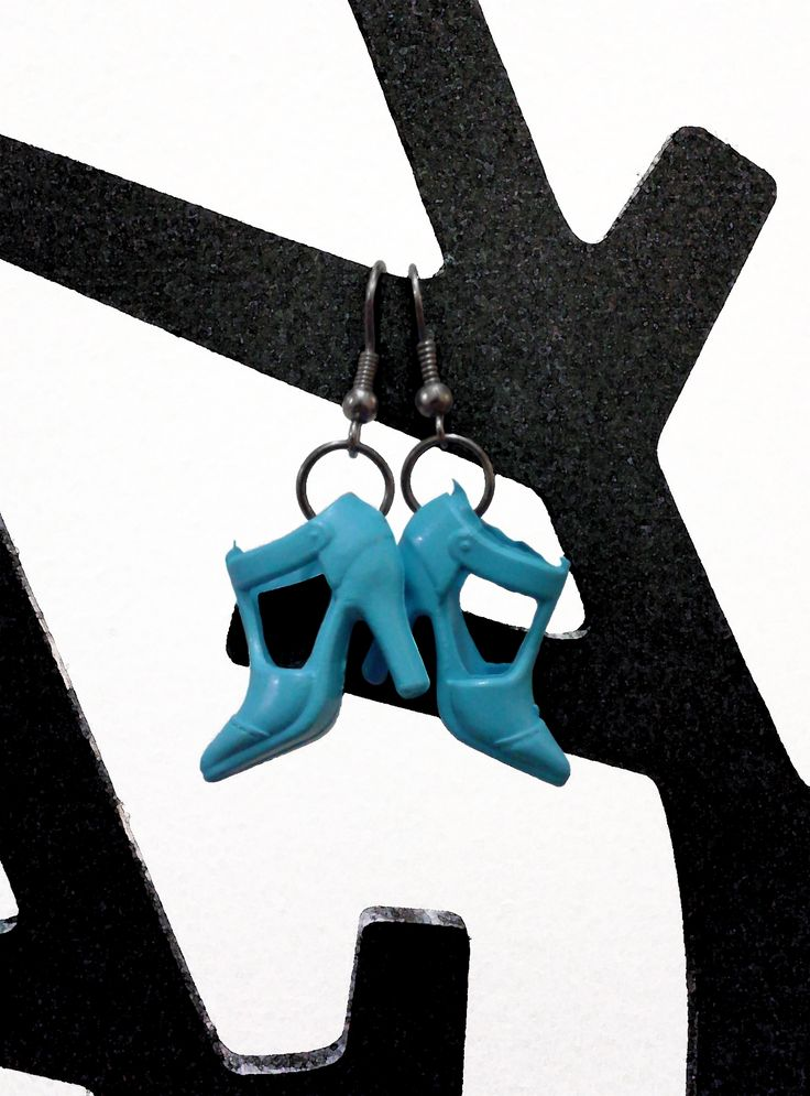 A+pair+of+small+blue+plastic+Barbie+heels+on+gunmetal+grey+hardware.  Nickel+and+lead+free+hook+earrings. Includes+clear+rubber+stoppers.