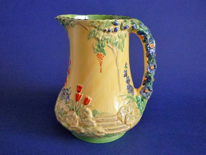 1377 best vintage pitchers jugs images on pinterest for Garden art from old dishes