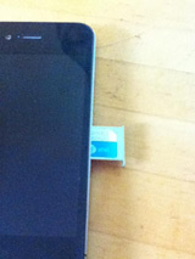How Does the iPhone's SIM Card Work?: The iPhone 4 SIM card, in its tray