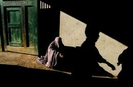 AFGHANISTAN. Kabul. 2002. Beggar and shadow. Published by Magnum Photos.