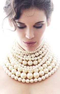 """""""She wore a pearl necklace"""""""