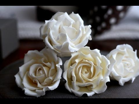 This is how I make my gumpaste roses when keeping them all edible.  If you want, you can use a styrofoam ball as the center instead of gumpaste to make them lighter and to be able to hang them upside down (on an insirted wire) while drying.  Have fun!!