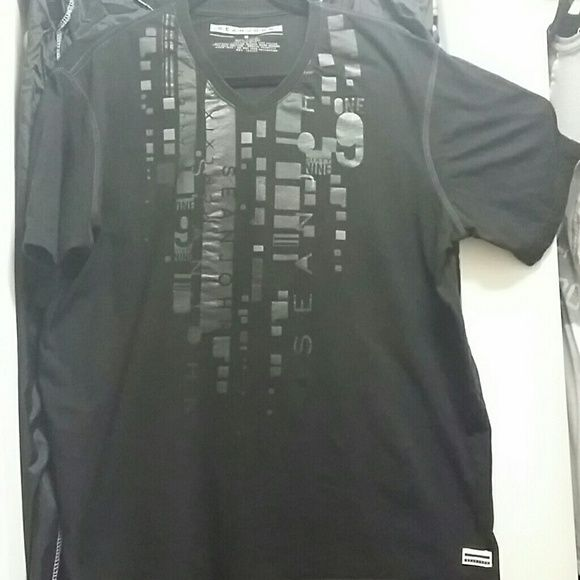 Black Sean John Tee Black Sean John Tee with pin size hole noted in last picture.  Price reflects. Worn once. Noticed the security alarm made the hole. Sean John  Tops Tees - Short Sleeve