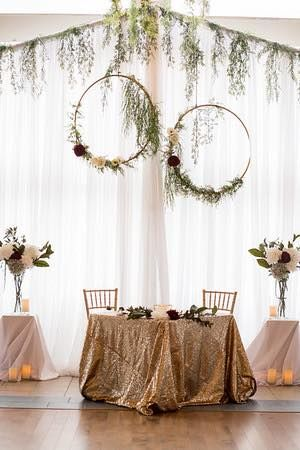 #sweethearttables #Cldesigns #cldesnteam #hulahoop #greenery #weddingbackdrop #floralaccents #gold #sequin #chiavarichairs