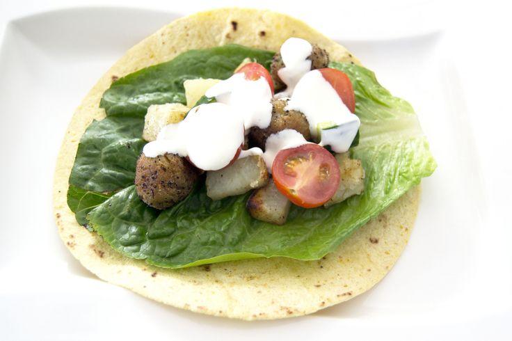 Spicy falafel patties with a hot potato, tomato salsa and garlic clicks