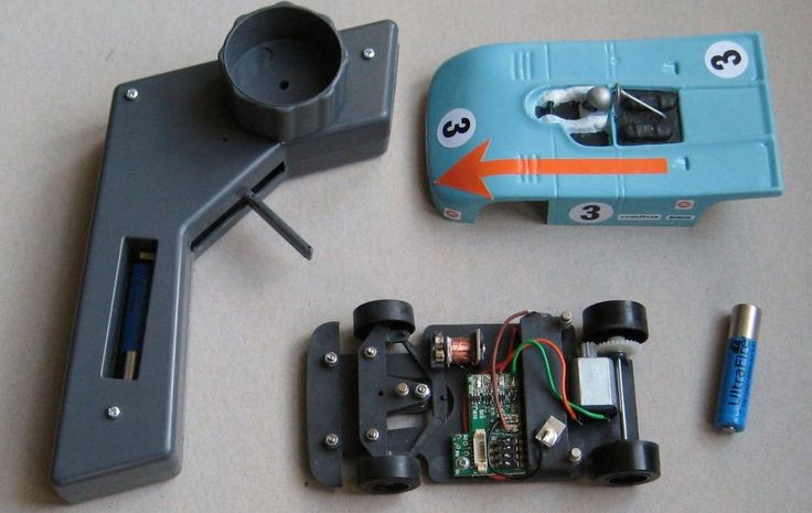 Magracing chassis, car, battery, bodyshell and controller. The same size 3.8 volt battery is used in both the car and controller.  The body is held in place using magnets and can be removed and refitted in less than one second!.