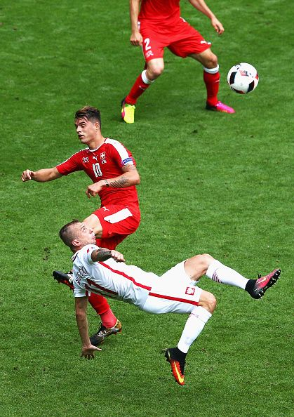 #EURO2016 Kamil Grosicki of Poland attempts an overhead kick while Granit Xhaka of Switzerland tries to block during the UEFA EURO 2016 round of 16 match...