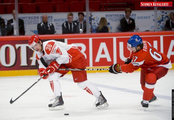 Denmark's Jannik Hansen, left, is speared by Czech Republic's Michael Frolik, right, during the group B Ice Hockey World Championship match between Denmark and Czech Republic in the Ericsson Globe Arena, Stockholm, Sweden, Friday May