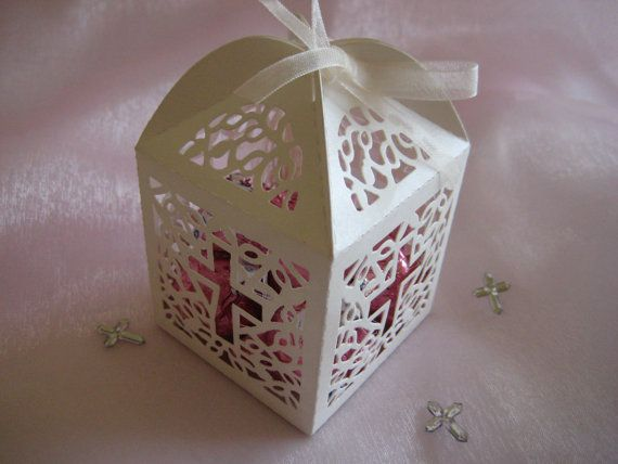 These white party favor boxes have a precision laser cut Holy Cross design on each side. They are perfect for Christening Favors, Baptism Party