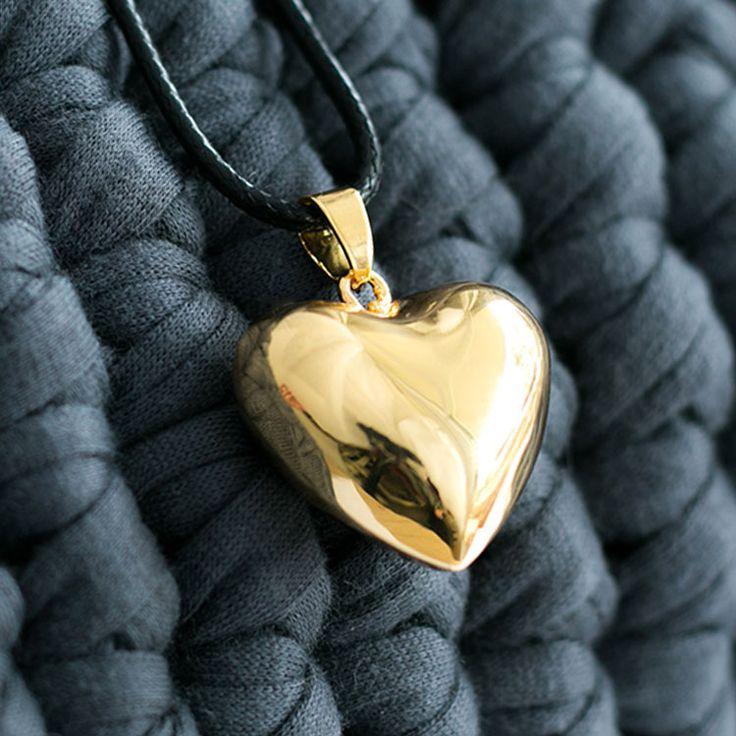 Bola de grossesse en forme de cœur totalement doré.