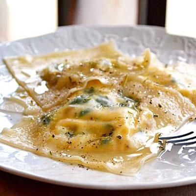 Spinach & Sausage Ravioli. This stuffed ravioli dish is a twist on the classic Italian pasta; they're made with thin wonton skins instead of pasta dough, so they're lighter but just as yummy. While the recipe certainly isn't authentic Italian or Asian food, it's a mouthwatering fusion of two totally different kinds of cuisine.
