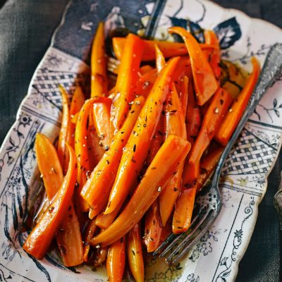 Angela Hartnett's honey and cumin caramelised carrots. Boil carrots ahead of time, then heat honey, butter and cumin and add carrots.