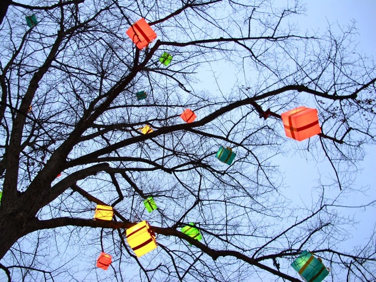 What is the significance of boo leaving the presents in the tree for jem and scout?