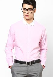 Complete your corporate look by wearing this pink formal shirt from United Colors of Benetton. Featuring excellent finish and a contrast-coloured collar, this slim-fit shirt will lend you a smart look in no time. Team this cotton shirt with a pair of formal trousers and dress shoes to make a cool fashion statement.