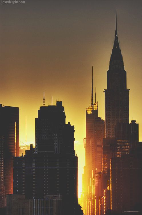 New York skyline dark sky city sunset sun buildings. light