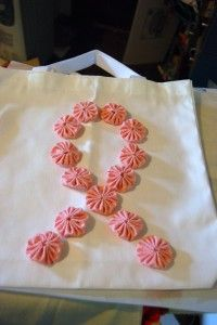 @Jenny @CraftTestDummy designed this cute Pink Ribbon Tote for Breast Cancer Awareness. Easy to make with fabric yo-yos.
