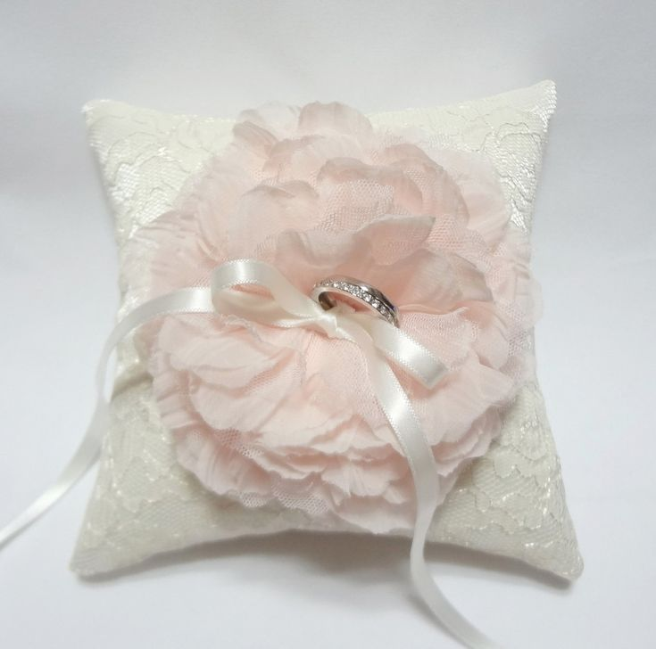 Wedding ring pillow light pink bloom on ivory lace ring pillow. $35.00, via Etsy.