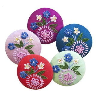 Add beautiful, bright colour to any summer outfit with this stunning 100% silk taffeta brooch.