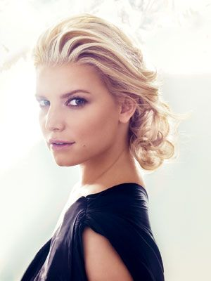 Jessica Simpson romantic, swept-back, low bun updo