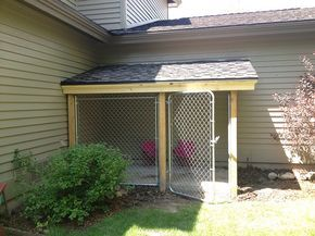 Covered dog area for Roxie, without the concrete.  Could be used when the snow level is above her head.  Doggie door installed so she can use it, or go right out to the yard thru open gate.