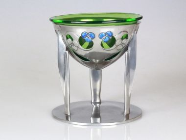 Liberty & co Tudric pewter coupe. Designed by Archibald Knox c 1902-1905 This is a rarely seen version with vibrant blue enamels  with a hand blown green glass liner In excellent condition all the enamels are perfect  Marked to base TUDRIC 0276
