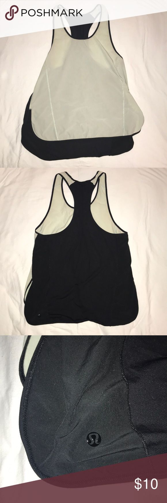 Lululemon Workout Top - Sz 8 Cute lose fitting Lululemon Workout Top in mint and black is a Workout staple. It even has snaps to clip in your sports bra for comfort!   READ: Shows signs of wear (see pics). Small stain on the front, and some pulling on the front side.   Price reflects wear. lululemon athletica Tops