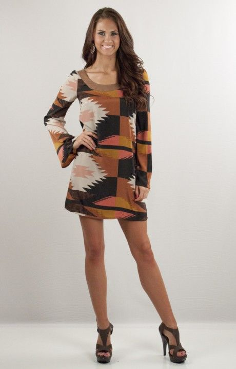 Earth tones and aztec - two trends that flatter and flaunt through the Summer and Fall! This adorable Judith March dress is back by popular demand. The gorgeous mix of colors bring our your tan and let you show off those legs!