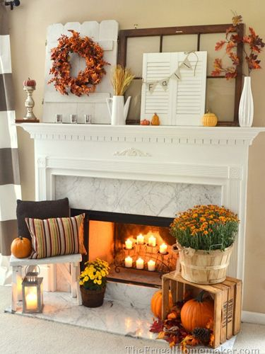 Blogger Christina of The Frugal Homemaker used flea-market finds—a $2 wood crate, a white stool found at a yard sale, and a screen from Value Village—to add extra dimension to her fall mantel.  See more at The Frugal Homemaker.  RELATED: 17 Homemade Halloween Decorations