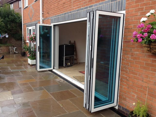 set of 6 bifolding doors in white aluminium opening from the middle