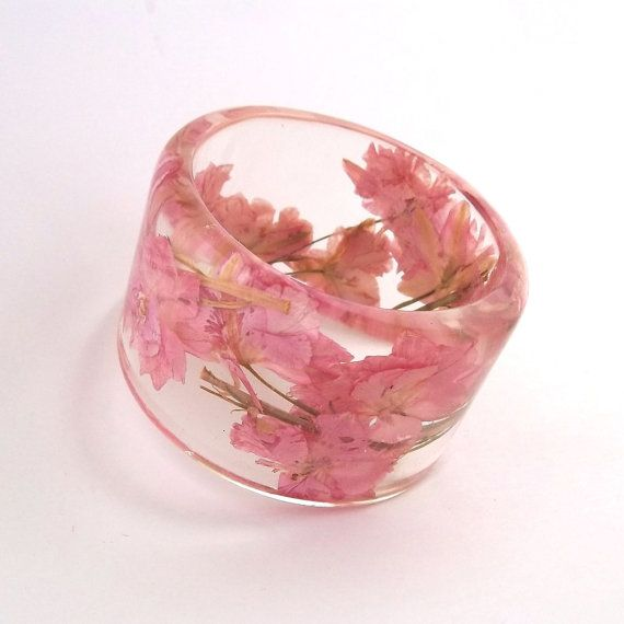 Romantic Resin Bangle.  Unique Pink Bracelet with Pressed Flowers.  Pink Larkspur in Large Bangle. $44.00, via Etsy.