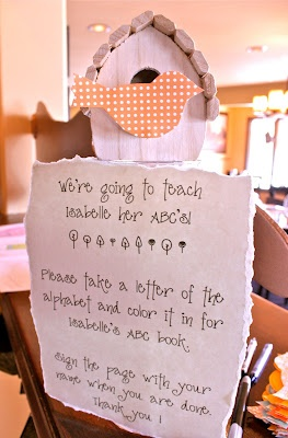This is a cute idea...have the guest color a page for their babies ABC book!!! @Tara Harmon Bardella   So CUTE!!