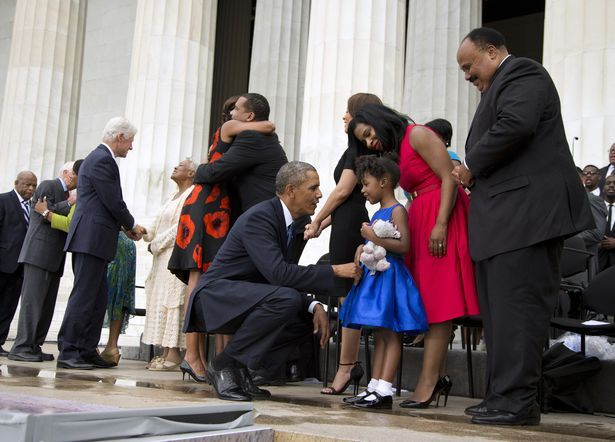 "President Barack Obama talks with Yolanda Renee King, 5, granddaughter of Martin Luther King Jr., her mother Arndrea Waters, and Martin Luther King III, right, after speaking at a ceremony commemorating the 50th anniversary of the March on Washington, Wednesday, Aug. 28, 2013, at the Lincoln Memorial in Washington. The president was set to lead civil rights pioneers Wednesday in a ceremony for the 50th anniversary of the March on Washington, where Dr. Martin Luther King's ""I Have a Dream""…"