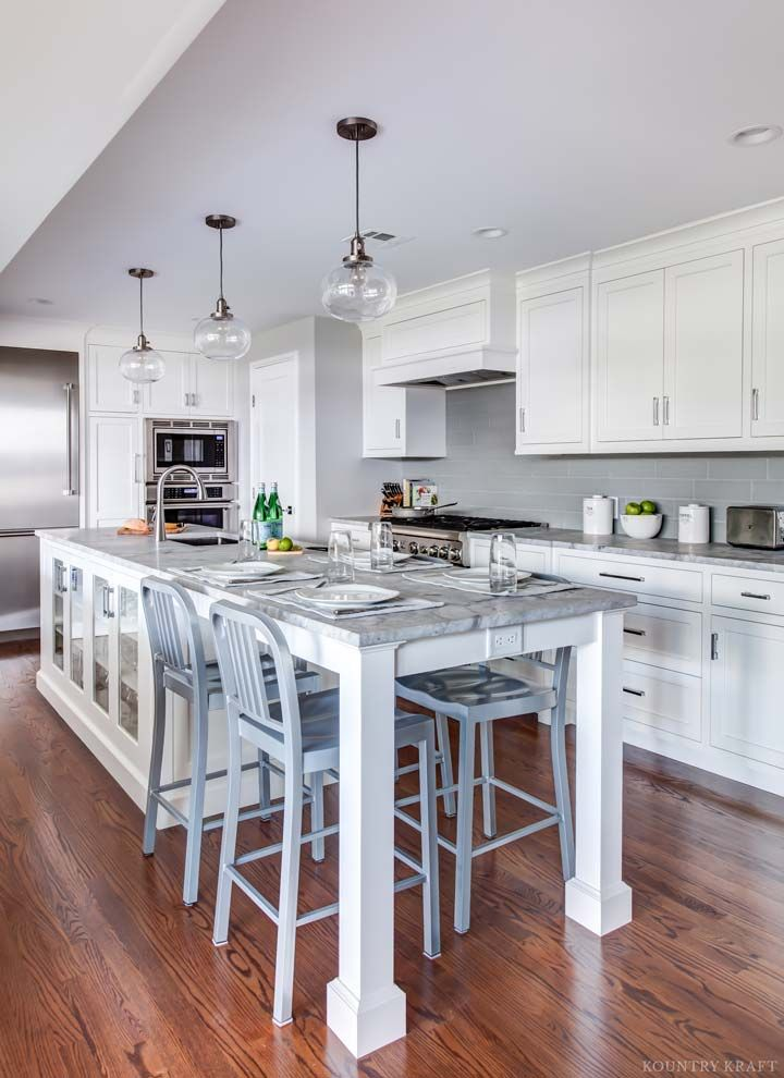 Custom Kitchen Island with Seating and Food Prep Space. #KountryKraft #CustomCabinetry #CustomKitchenCabinets http://www.kountrykraft.com/photo-gallery/white-inset-cabinets-madison-nj-j106090/