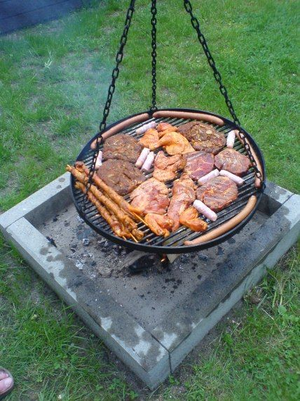 Schwenkers (Yes it sounds naughty) offer a different approach for outdoor grilling. The griller and a friend or three can push this hanging grill back and forth over a bed of coals to get a more even cooking heat.