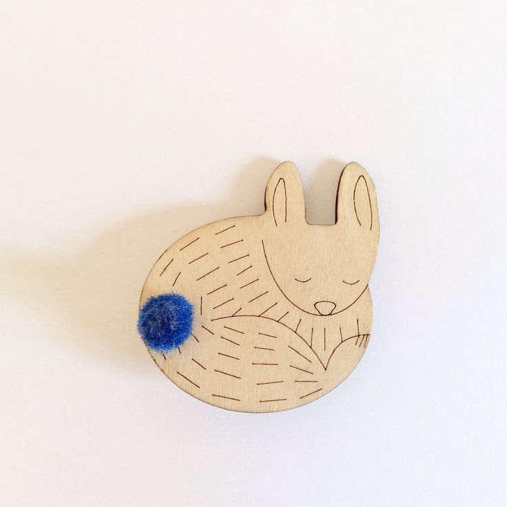 Brooch rabbit in wood laser cut. Design: Eva Guillet. https://www.etsy.com/fr/shop/MilkyWood?ref=hdr_shop_menu