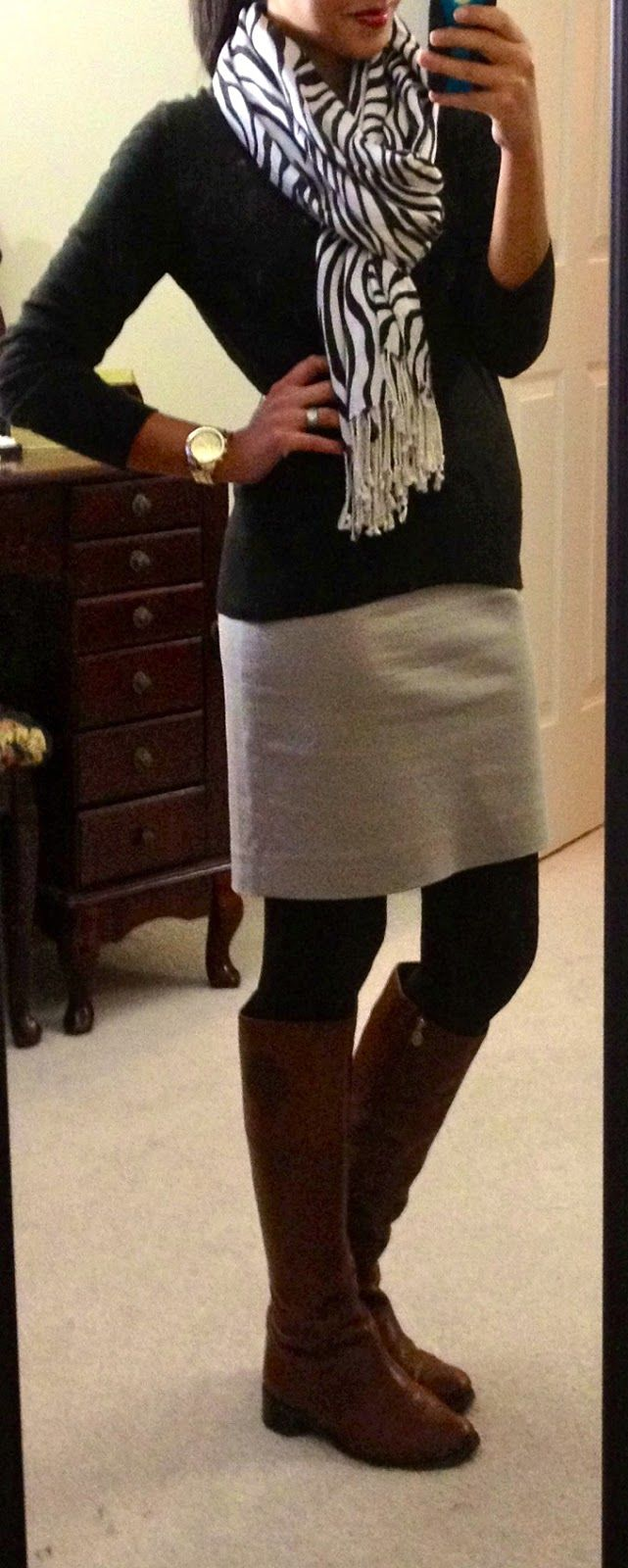 statement scarf, skirt, tights & boots (I love that the outfit is black, white, and gray and that it's ok to wear brown boots!)