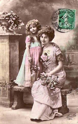 Vintage photo beautiful tinted - woman and child with stamp and postmark.