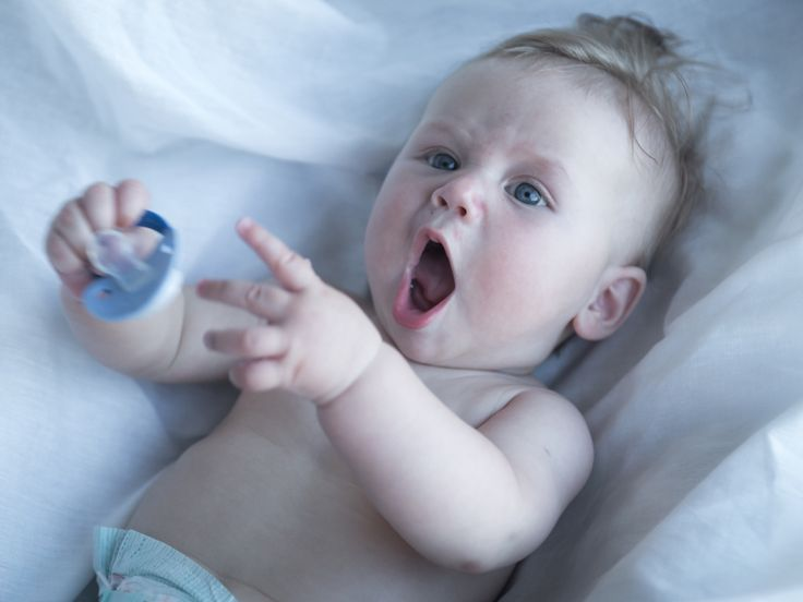 The Pacifier Problem: Ending Your Toddler's Habit - Kamo - baby playing with pacifier