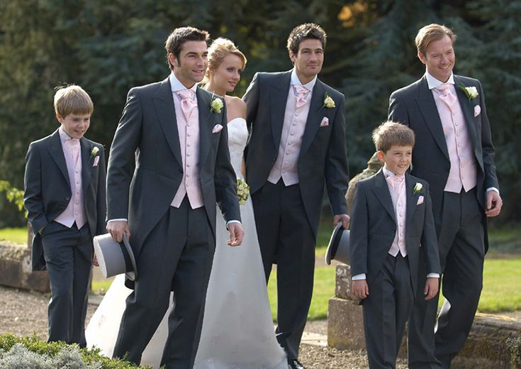 No sir, I'm not buying it. Nobody owns matching pink waistcoats and ties as a clan. This, sir, is a hire! Furthermore, the waistcoats are low enough to wear with Levis.