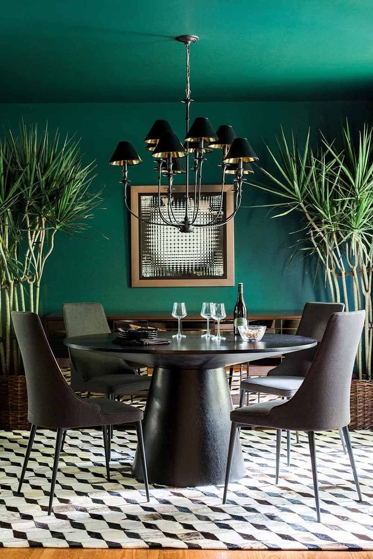 Bold forest green dining room designed by Brian Patrick Flynn. Image by Rustic White Photography. See more at StyleBlueprint.com